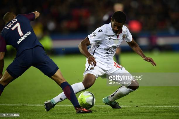 Paris SaintGermain's Brazilian midifelder Lucas vies with Nice's Brazilian defender Santos Marlon during the French L1 football match between Paris...