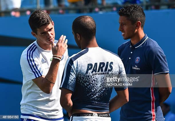 Paris SaintGermain's Brazilian players Marquinhos and Lucas Moura speak with Chelsea's Brazilian midfielder Oscar before an International Champions...