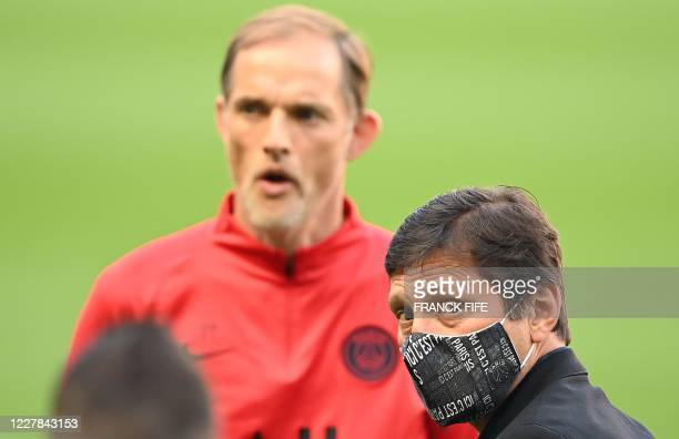 Paris Saint-Germain's Brazilian sporting director Leonardo and Paris Saint-Germain's German head coach Thomas Tuchel look on ahead of a training...