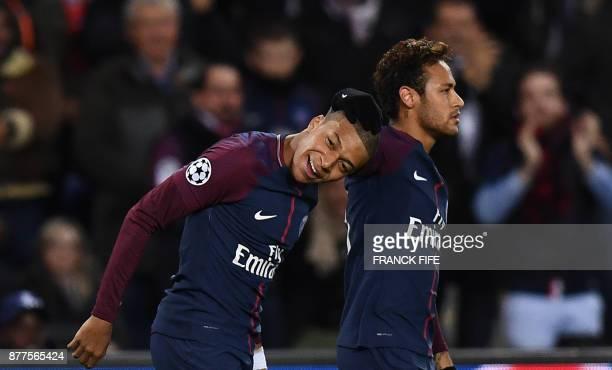 Paris SaintGermain's Brazilian striker Neymar and French striker Kylian Mbappe react during the UEFA Champions League Group B football match between...