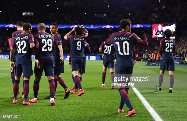 Paris SaintGermain's Brazilian striker Neymar celebrates after scoring during the UEFA Champions League Group B football match between Paris...
