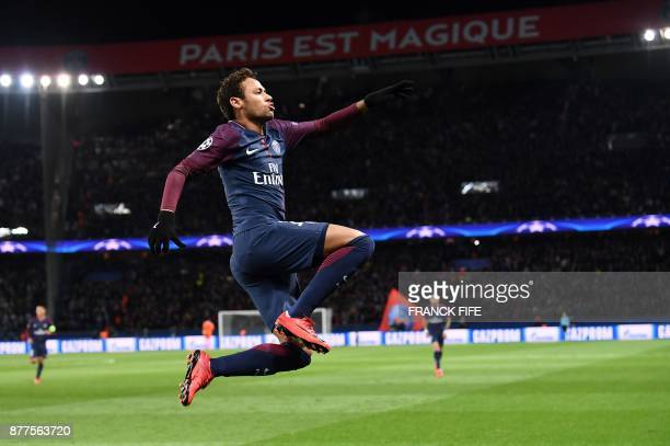 Paris SaintGermain's Brazilian striker Neymar celebrates his second goal during the UEFA Champions League Group B football match between Paris...