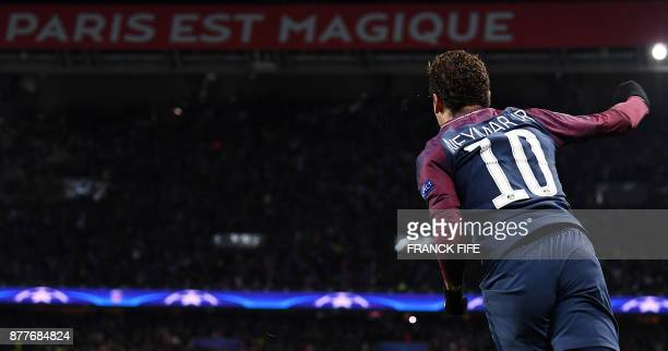 TOPSHOT Paris SaintGermain's Brazilian striker Neymar celebrates his second goal during the UEFA Champions League Group B football match between...
