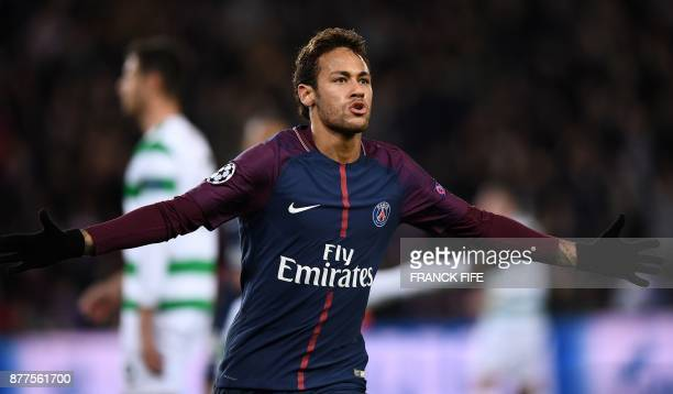 Paris SaintGermain's Brazilian striker Neymar celebrates scoring his second goal during the UEFA Champions League Group B football match between...
