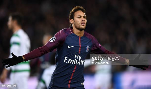 TOPSHOT Paris SaintGermain's Brazilian striker Neymar celebrates scoring his second goal during the UEFA Champions League Group B football match...