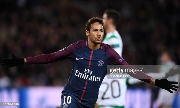 Paris SaintGermain's Brazilian striker Neymar celebrates scoring his second goal during the UEFA Champions League Group B football match between...