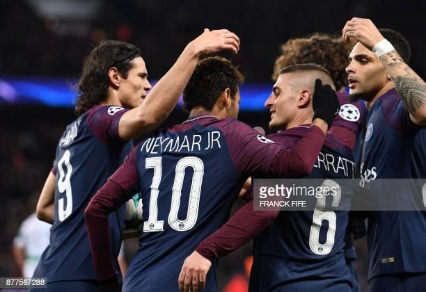 Paris SaintGermain's Brazilian striker Neymar celebrates with teammates Italian midfielder Marco Verratti French defender Layvin Kurzawa and...