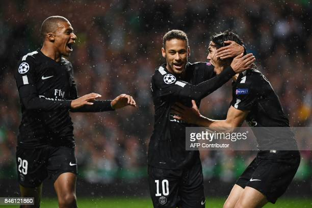 Paris SaintGermain's Brazilian striker Neymar celebrates with Paris SaintGermain's French striker Kylian Mbappe and Paris SaintGermain's Uruguayan...