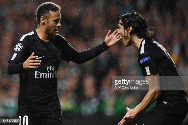 Paris SaintGermain's Brazilian striker Neymar celebrates with Paris SaintGermain's Uruguayan striker Edinson Cavani after scoring the opening goal of...