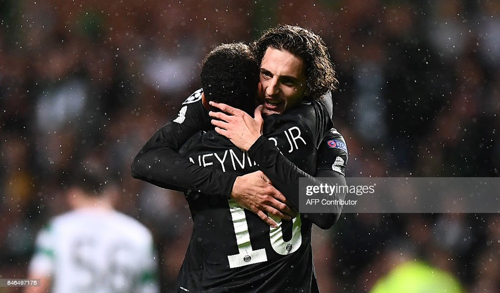 Paris Saint-Germain's Brazilian striker Neymar (L) celebrates with Paris Saint-Germain's French midfielder Adrien Rabiot (R) after scoring the opening goal of the UEFA Champions League Group B football match between Celtic and Paris Saint-Germain (PSG) at Celtic Park in Glasgow, on September 12, 2017. /