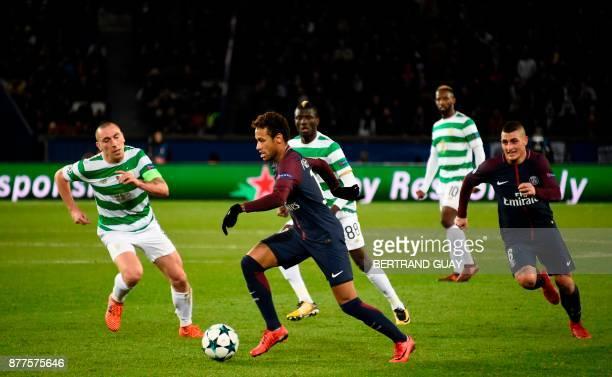 Paris SaintGermain's Brazilian striker Neymar controls the ball as Celtic's Scottish midfielder Scott Brown and teammate Paris SaintGermain's Italian...
