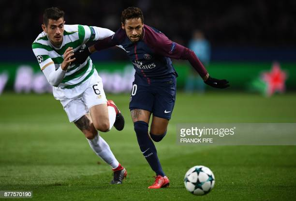 Paris SaintGermain's Brazilian striker Neymar fights for the ball with Celtic's Israeli midfielder Nir Bitton during the UEFA Champions League Group...