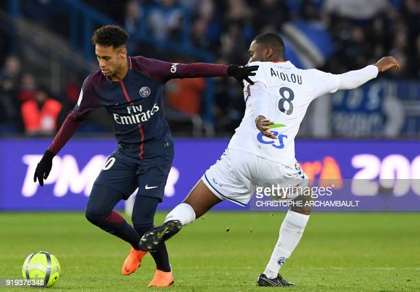 TOPSHOT Paris SaintGermain's Brazilian striker Neymar fights for the ball with Strasbourg's Ivorian defender JeanEudes Aholou during the French Ligue...