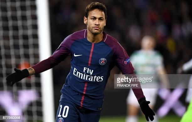 Paris SaintGermain's Brazilian striker Neymar gestures after scoring during the UEFA Champions League Group B football match between Paris...