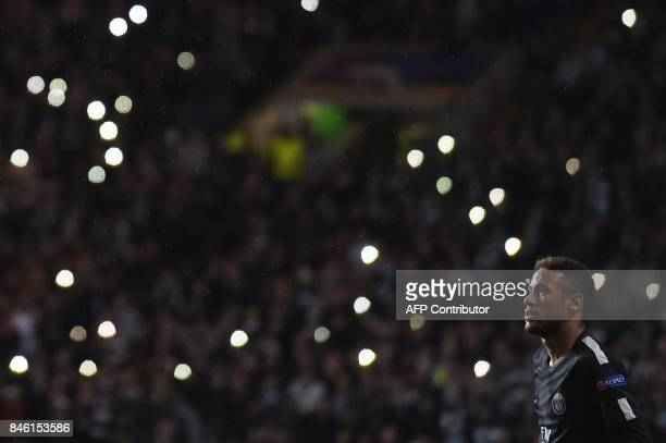 TOPSHOT Paris SaintGermain's Brazilian striker Neymar stands in front of a bank of fans shining their mobile torches during the UEFA Champions League...