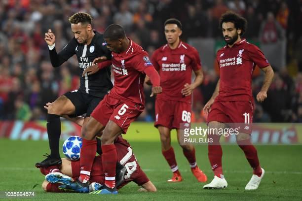 Paris Saint-Germain's Brazilian striker Neymar vies with Liverpool's Dutch midfielder Georginio Wijnaldum atop Liverpool's English midfielder Jordan...