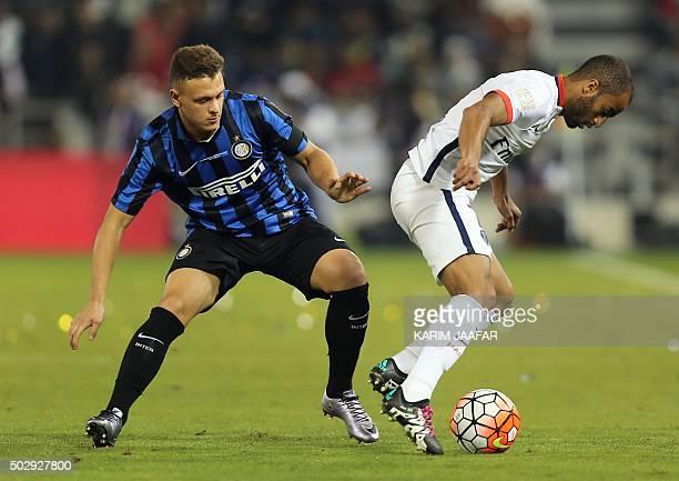 Paris SaintGermain's Brazilian winger Lucas Moura dribbles past Inter Milan's Italian defender Federico Dimarco during the friendly football match...