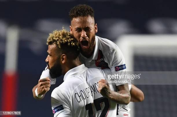 Paris Saint-Germain's Cameroon forward Eric Maxim Choupo-Moting celebrates with Paris Saint-Germain's Brazilian forward Neymar after scoring a goal...