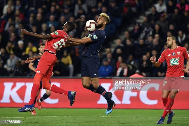 Paris SaintGermain's Cameroonian forward Eric ChoupoMoting jumps for the ball with Dijon's French defender Senou Coulibaly during the French Cup...