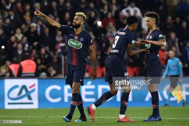 Paris SaintGermain's Cameroonian forward Eric ChoupoMoting Paris SaintGermain's French defender Presnel Kimpembe and Paris SaintGermain's German...