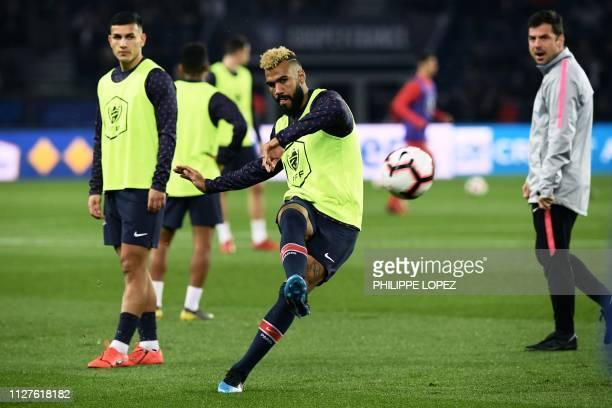 Paris SaintGermain's Cameroonian forward Eric ChoupoMoting warms up prior to the French Cup quarterfinal football match between Paris SaintGermain...