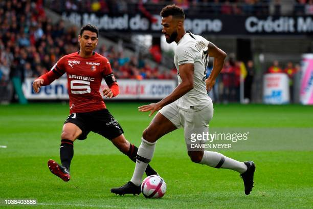 Paris SaintGermain's Cameroonian forward Eric Maxim ChoupoMoting drives the ball past Rennes' French midfielder Benjamin Andre during the French L1...