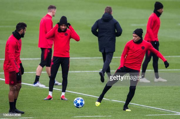 Paris SaintGermain's Cameroonian forward EricMaxim ChoupoMoting French midfielder Christopher Nkunku and French forward Kylian Mbappe take part in a...