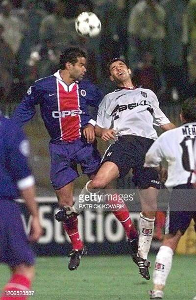 Paris Saint-Germain's captain Raï duels in the air with Besiktas Istanbul's defender Rahim Zafer, 01 October in Istanbul, during their European...