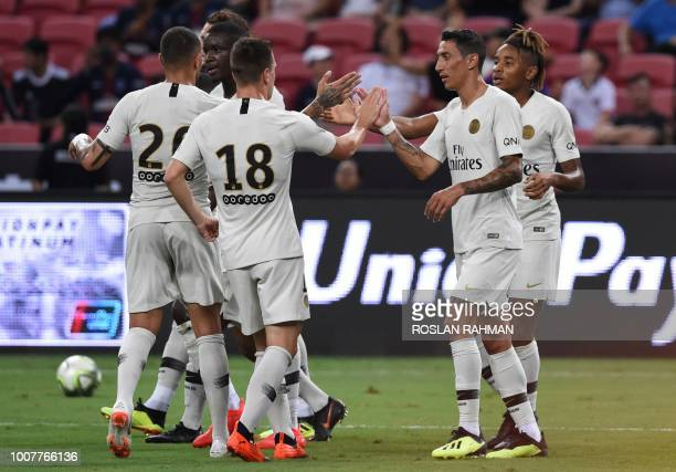 TOPSHOT Paris SaintGermain's Christopher Nkunku celebrates scoring with his teammates during the International Champions Cup football match between...