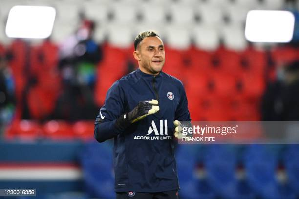 Paris Saint-Germain's Costa Rican goalkeeper Keylor Navas looks on as he trains before the UEFA Champions League group H football match between Paris...