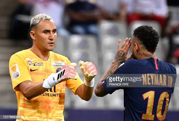 Paris Saint-Germain's Costa Rican Keylor Navas and Paris Saint-Germain's Brazilian forward Neymar shake hands during a penalty shoot during the...