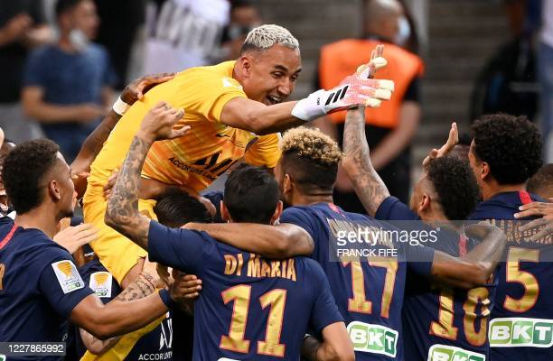Paris Saint-Germain's Costa Rican Keylor Navas is congratuled by teammates at the end of a penalty shoot during the French League Cup final football...