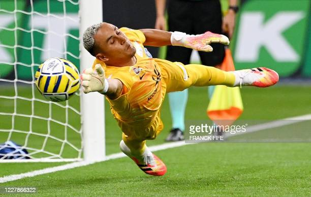 Paris Saint-Germain's Costa Rican Keylor Navas jumps for the ball during the penalty shoot-out at the French League Cup final football match between...
