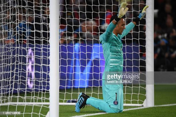 Paris Saint-Germain's Costa Rican Keylor Navas prays at the start of the UEFA Champions league Group A football match between Paris Saint-Germain and...
