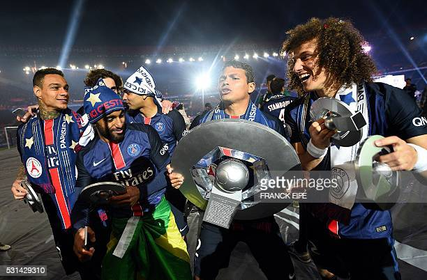 Paris SaintGermain's Dutch defender Gregory Van der Wiel Brazilian midfielder Lucas Moura Brazilian defender Thiago Silva and Brazilian defender...