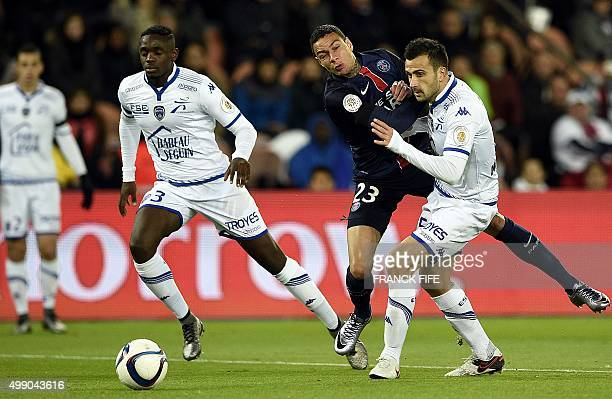 Paris SaintGermain's Dutch defender Gregory Van der Wiel challenges Troyes' French defender Matthieu Saunier during the French L1 football match...