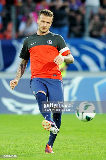 Paris Saint-Germain's English midfielder David Beckham warms up prior to the French Cup football match Evian vs Paris on April 17, 2013 at the city...