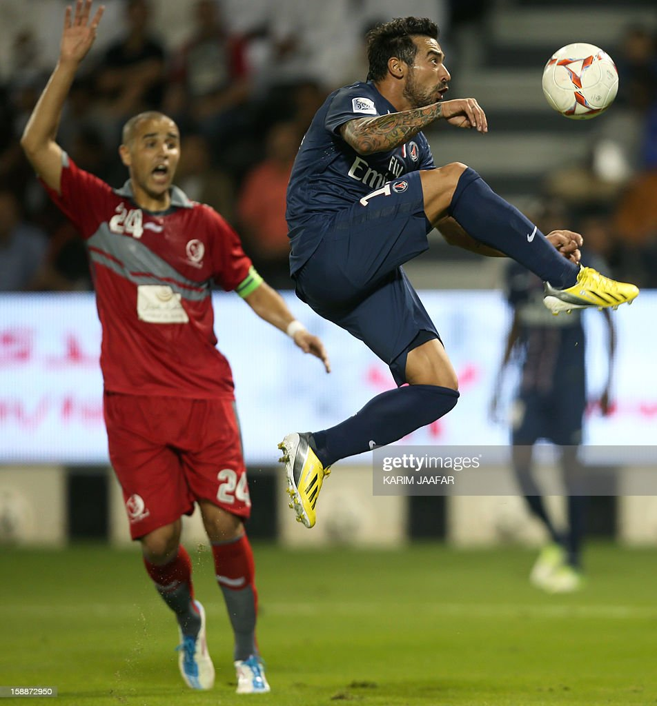Paris Saint-Germain's Ezequiel Lavezzi (R) challenges Qatar's Lekhwiya Algerian defender Madjid Bougherra (L) during a friendly football match in the Qatari capital Doha on January 2, 2013. PSG won 5-1.
