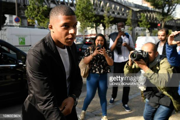 Paris SaintGermain's forward Kylian Mbappe arrives at French football federation headquarters prior to his appeal hearing before the FFF disciplinary...
