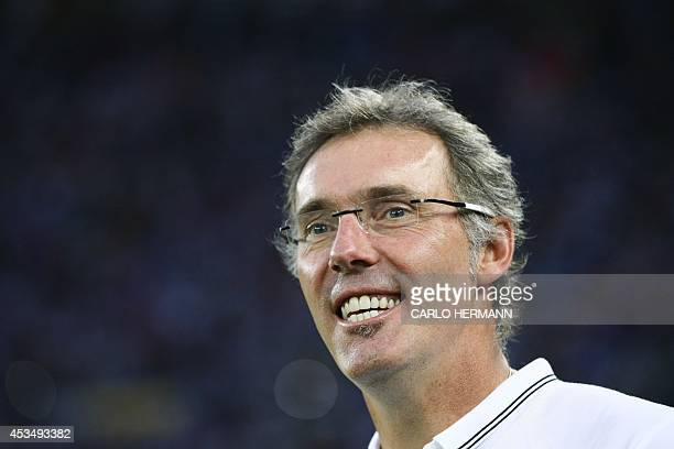 Paris SaintGermain's French coach Laurent Blanc smiles prior to the friendly football match between SSC Napoli and Paris SaintGermain FC as part of...
