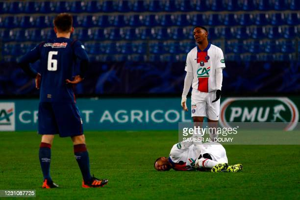 Paris Saint-Germain's French defender Abdou Diallo complains as Paris Saint-Germain's Brazilian forward Neymar lies on the pitch during the French...