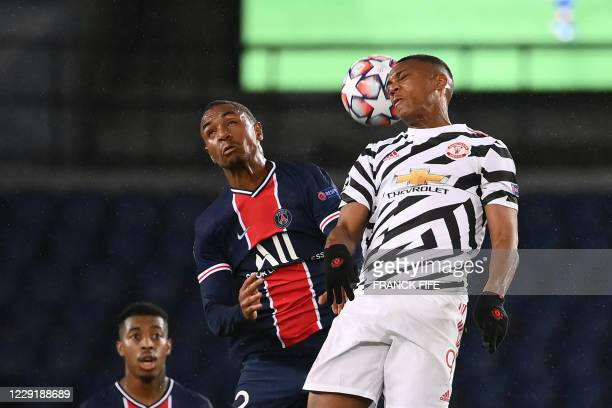 Paris SaintGermain's French defender Abdou Diallo jumps for the ball with Manchester United's French forward Anthony Martial during the UEFA...