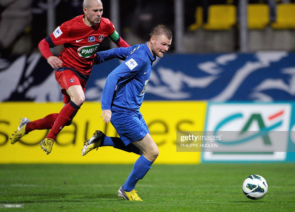 Paris Saint-Germain's French defender Christophe Jallet (L) vies with Arras forward Despres Arnaud during the French cup football match Arras vs Paris Saint-Germain, on January 6, 2013 at the Epopee Stadium in Calais, northern France.