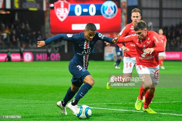 Paris Saint-Germain's French defender Colin Dagba and Brest's French defender Romain Perraud vie for the ball during the French L1 football match...