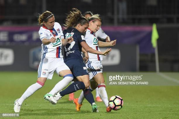 Paris Saint-Germain's French defender Eve Perisset vies with Lyon's French midfielder Camille Abily and Lyon's French forward Eugenie Le Sommer...