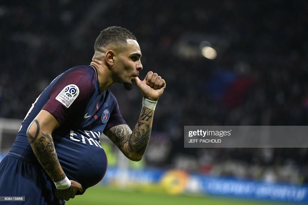 Paris Saint-Germain's French defender Layvin Kurzawa celebrates after scoring a goal during the French L1 football match between Olympique Lyonnais and Paris-Saint Germain (PSG) at Groupama stadium in Decines-Charpieu on January 21, 2018. /