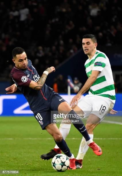 Paris SaintGermain's French defender Layvin Kurzawa controls the ball as Celtic's Australian midfielder Tom Rogic looks on during the UEFA Champions...