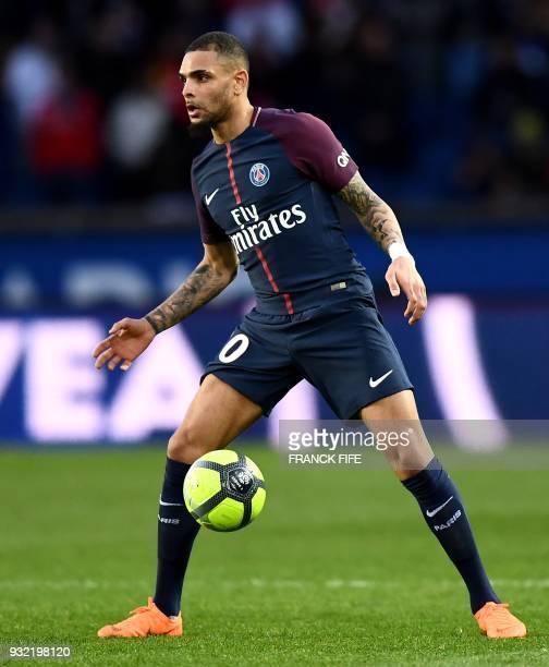 Paris SaintGermain's French defender Layvin Kurzawa controls the ball during the French L1 football match between Paris SaintGermain and Angers at...