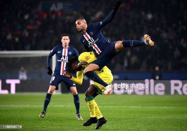 TOPSHOT Paris SaintGermain's French defender Layvin Kurzawa fights for the ball with Nantes' French midfielder Abdoul Kader Bamba during the French...