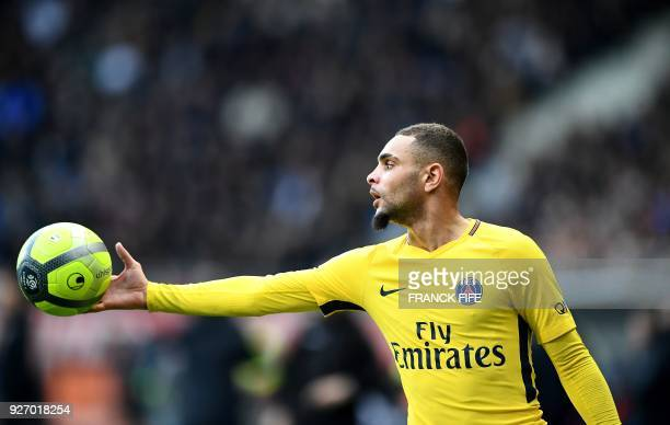 Paris SaintGermain's French defender Layvin Kurzawa holds a ball during the French L1 football match between Troyes and Paris SaintGermain at the...